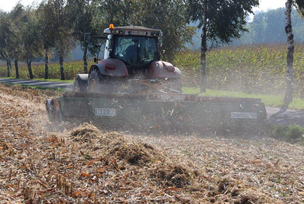 A tractor with BIOCHIPPER at the rear during harvesting crops